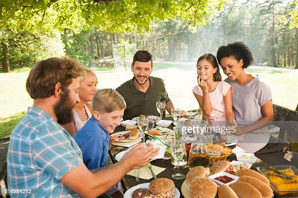 Family and friends having picnic outdoors