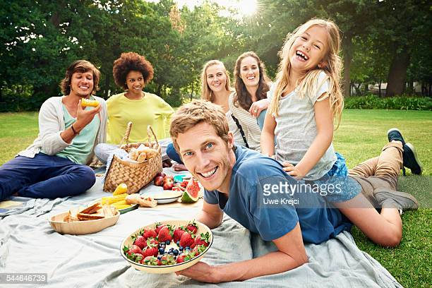 Family and friends having picnic