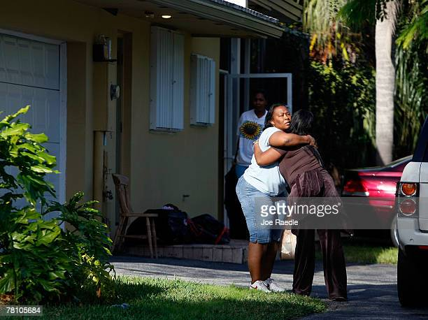 Family and friends hug in front of the home where an intruder shot and killed Washington Redskins football player Sean Taylor November 27 2007 in...