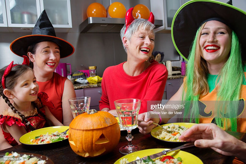 Family and friends laughing at Halloween party. : Stock Photo