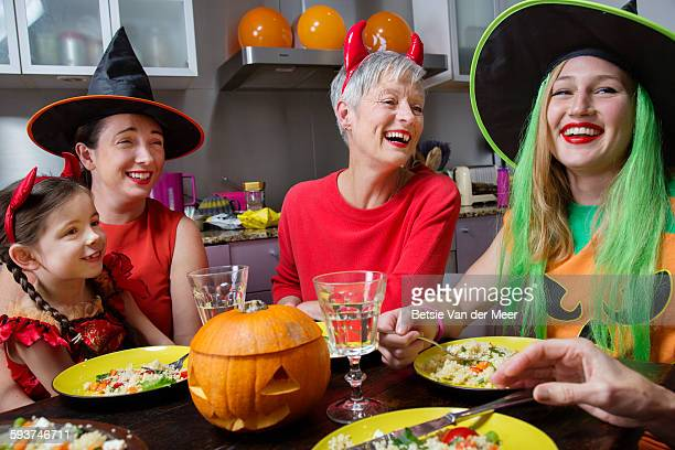 family and friends laughing at halloween party. - devil costume stock photos and pictures