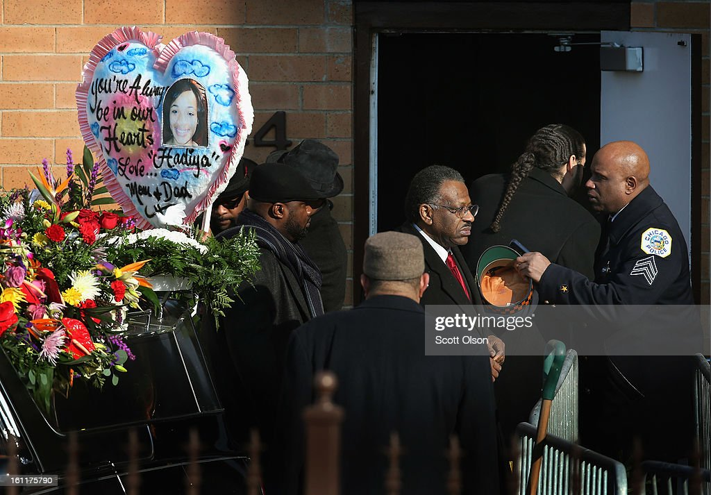 Family and friends leave the Greater Harvest M.B. Church following the funeral of 15-year-old Hadiya Pendleton on February 9, 2013, in Chicago, Illinois. Hadiya was killed on January 29, when a gunman opened fire on her and some friends while they were standing under a shelter on a warm rainy afternoon in a park about a mile from President Obama's Chicago home. First lady Michelle Obama attended the funeral with Senior White House Adviser Valerie Jarrett and Secretary of Education Arne Duncan.