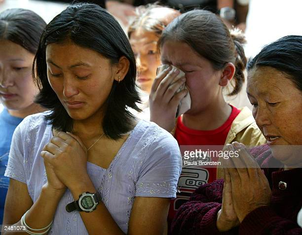 Family and friends mourn at the cremation of 28yearold Everest climber and Sherpa guide Karma Gyalzen May 27 2003 in Kathmandu Nepal Gyalzen died on...