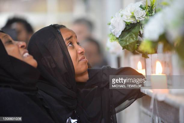 Family and friends mourn their beloved at the Cemetery of victims of Ethiopian Airlines Flight 302 during the commemoration of the first year...