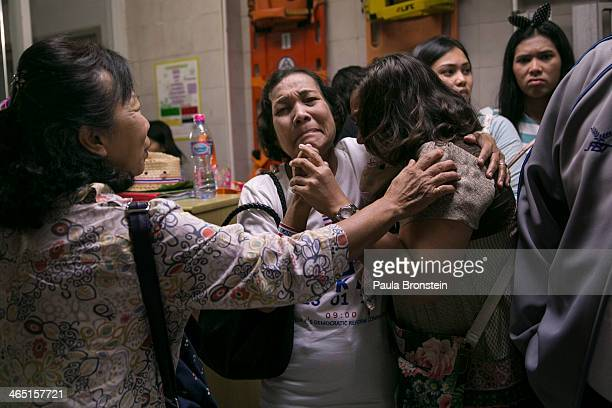 Family and friends of a Thai antigovernment protest leader who was shot dead grieve at a hospital as advanced voting for the February 2nd general...