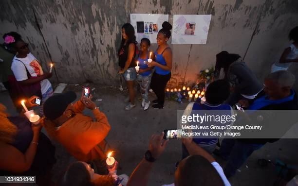 Family and friends of Alicia Todd gather in an alley to mark the anniversary of her killing in Long Beach CA on Friday June 24 2016 Family and close...