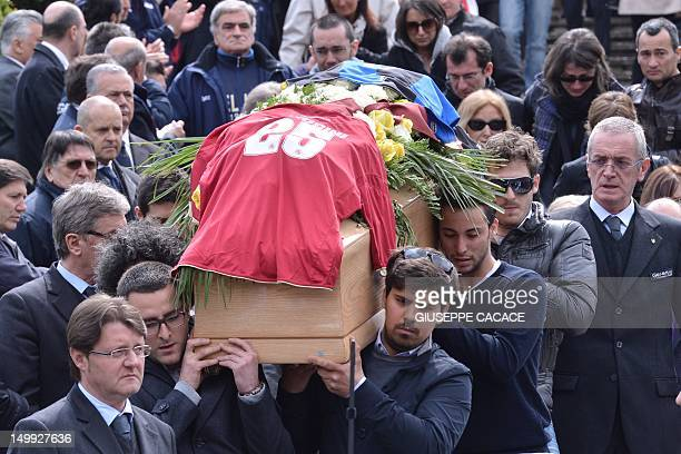 Family and friends of footballer Piermario Morosini follow his coffin after the funeral service at a church on April 19, 2012 in Bergamo. The...