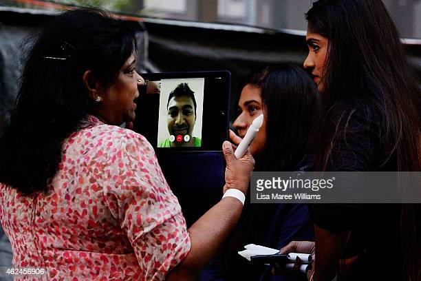 Family and friends of Myuran Sukumaran speak with Myuran on Skype via an iPad during the Music for Mercy concert and vigil at Martin Place on January...