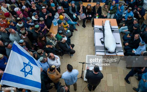 Family and friends of Rabbi Itamar Ben Gal mourn during his funeral in the West Bank settlement of Har Bracha on February 6 after he was killed last...