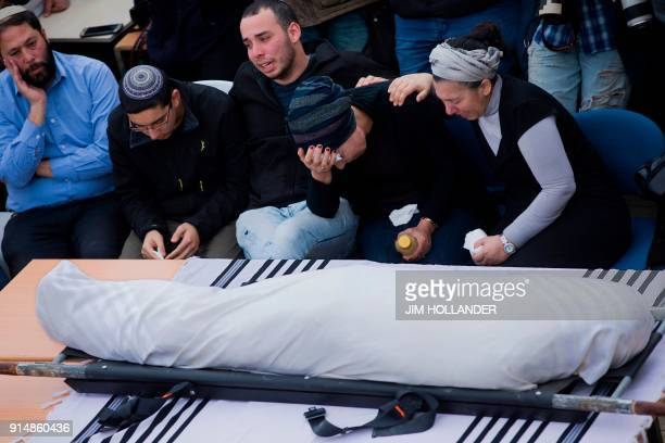 Family and friends of Rabbi Itamar Ben Gal mourn during his funeral in the West Bank settlement of Har Bracha on February 6 after he was killed the...