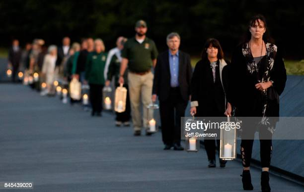 Family and friends of the victims carry candles at Flight 93 National MemorialÕs annual Luminaria on the eve of 16th Anniversary ceremony of the...