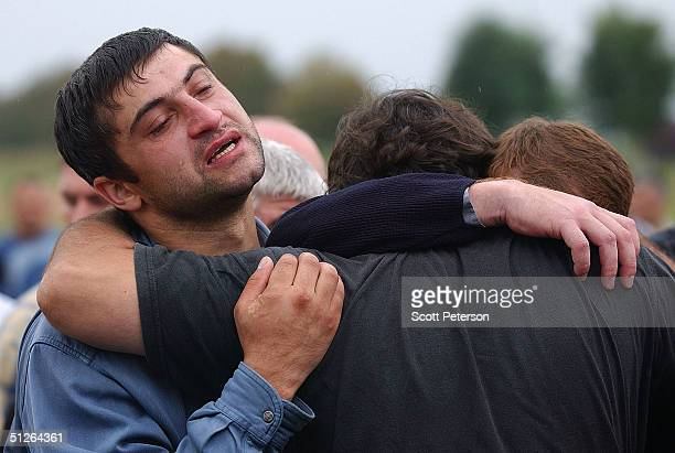 Family and friends of those in a school hostage crisis begin to bury more than 350 killed September 5 2004 in Beslan southern Russia Victims died...