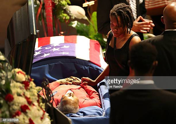 Family and friends pay their respects to retired Air Force Lt Col Eldridge Williams during his funeral at the Sweet Home Missionary Baptist Church on...