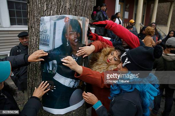 Family and friends post a photo of Bettie Jones who along Quintonio LeGrier was shot and killed by police during a vigil outside the West Garfield...