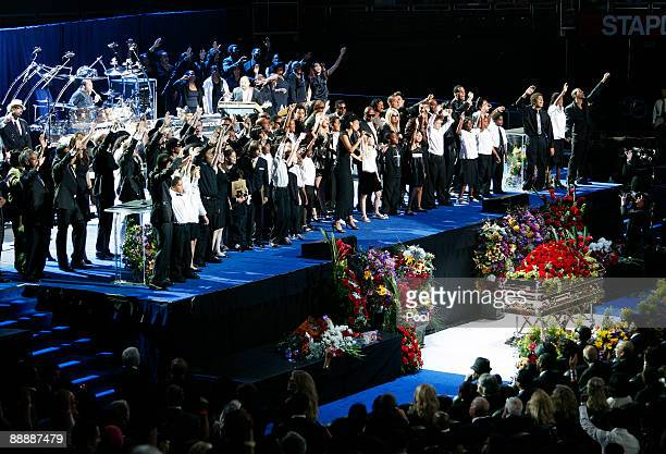 Family and friends sing the song We Are The World at the Michael Jackson public memorial service held at Staples Center on July 7 2009 in Los Angeles...