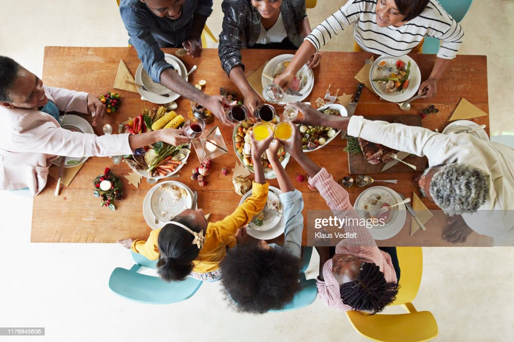 Family and friends toasting drinks at home : Stock Photo
