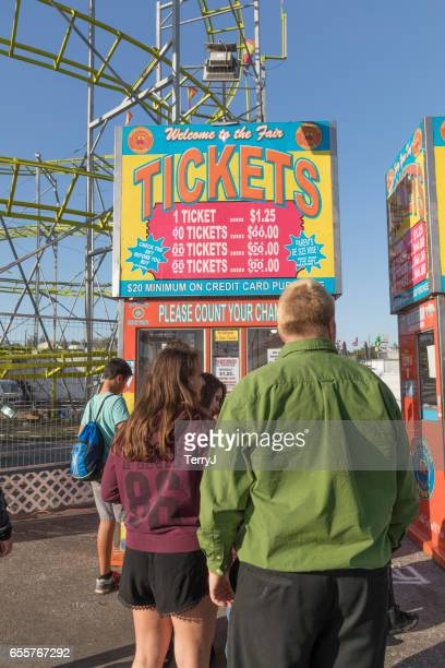 Family and Friends Wait in Line to Buy Tickets for the Collier County Fair