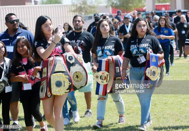 Family and friends walk into the Imperial Valley HS field during a homecoming parade for Heavyweight boxing champion Andy Ruiz Jr on June 22 2019 in...