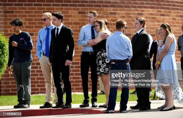 Family and friends watch as the hearse carrying the casket of shooting victim Kendrick Castillo leaves Cherry Hills Community Church after a...