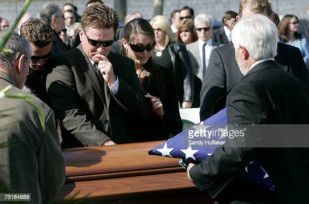 Family and friends weep over the coffin of Capt Brian Freeman during a memorial service at Ft Rosecrans National Cemetery on February 2 2007 in San...