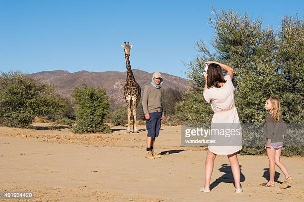 Family and giraffe on a walking safari
