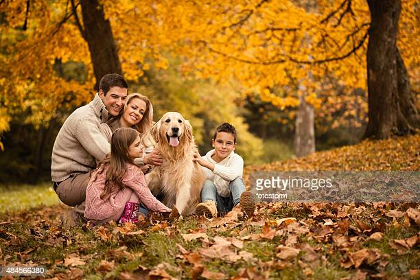 Family and Golden Retriever in the park