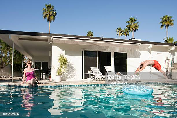 family and outdoor swimming pool - palm springs stock-fotos und bilder