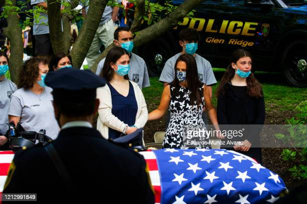 Family and police officers attend the funeral service of Glen Ridge Police Officer Charles Roberts after he passed away from the coronavirus on May...