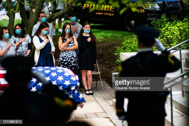 Family and police officers pay their respects to Glen Ridge Police Officer Charles Roberts during his funeral after he passed away from the...