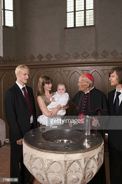 Family and Priests at Baptismal Font