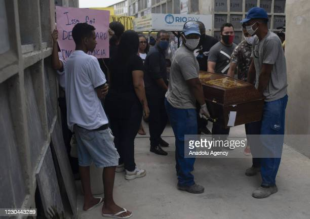 Family and relatives of Marcelo Guimaraes who died in one of the accesses to Cidade de Deus mourn as the body of him being buried in Inhauma Cemetery...