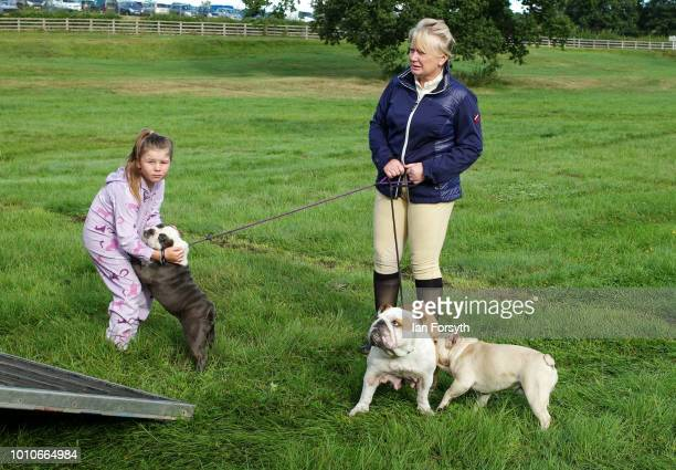 A family and their dogs stand at the back of their horse trailer at the 152nd the Ryedale Country Show on July 31 2018 in Kirbymoorside England Held...