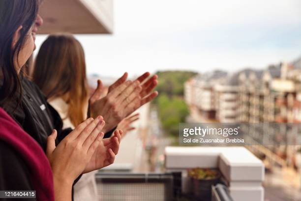 family applauding from the balcony of their home - balcony stock pictures, royalty-free photos & images