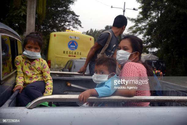A family are seen as they draw away from effected area by eruption in the community of San Miguel Los Lotes in Escuintla Guatemala on June 04 2018 At...
