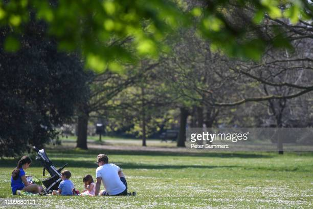Family are seen having a picnic in Greenwich Park on April 11, 2020 in London, England. Public Easter events have been cancelled across the country,...