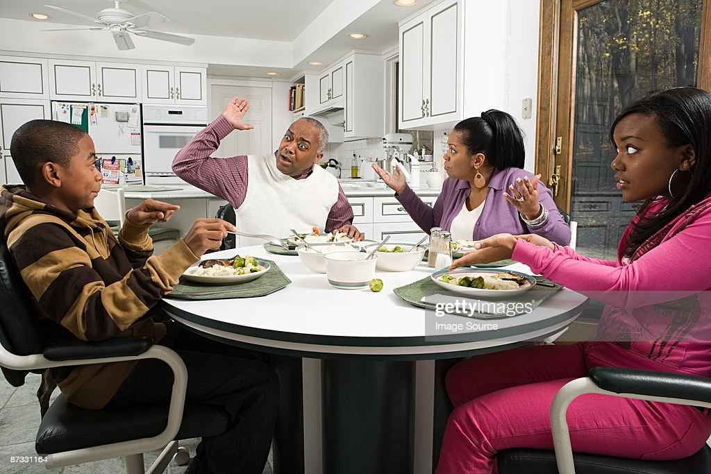 Family argument at the dinner table : Stock Photo