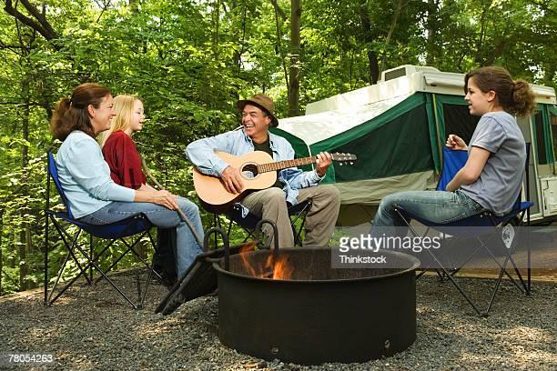 Family around campfire