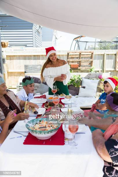 Family around Christmas lunch table outside