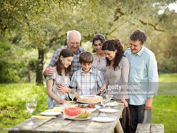 Family around table in countryside