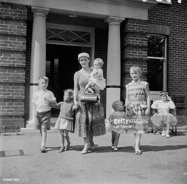 A family arrive at Hendon Aerodrome after travelling from Baghdad after escaping the Iraqi 14 July Revolution London 24th July 1958