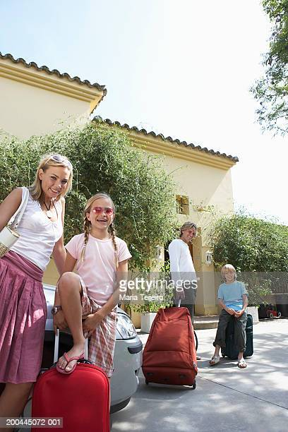 Family arriving at villa, portrait, low angle view