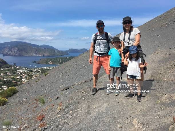 family ascending to the crater of vulcano island. aeolian islands, italy. - insel lipari stock-fotos und bilder