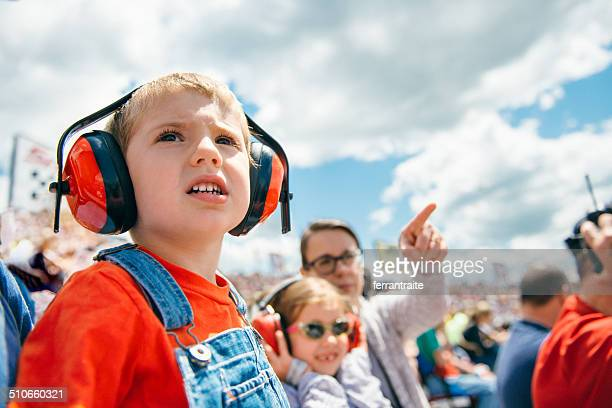 family at a car race - motorsport stock pictures, royalty-free photos & images