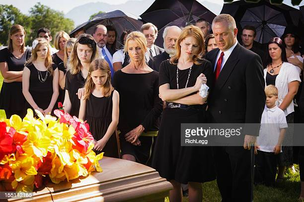 family at a funeral - funeral stock pictures, royalty-free photos & images