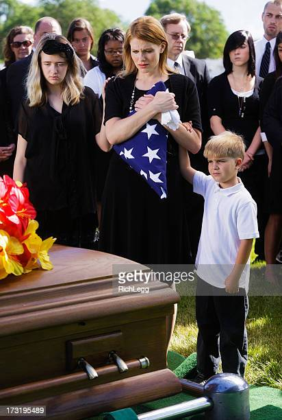 family at a funeral - folded flag stock pictures, royalty-free photos & images