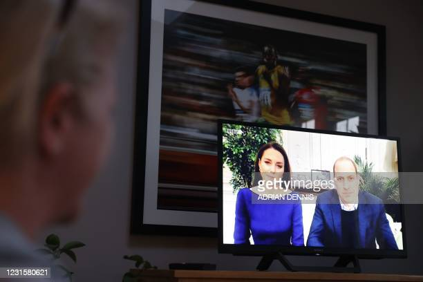 Family at a home in Hartley Wintney, west of London, on March 7, 2021 pose watching a special programme for Commonwealth Day showing Britain's Prince...