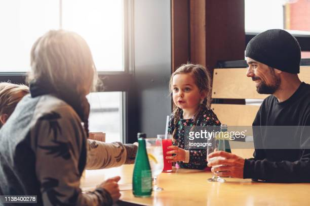 family at a ski resort - ski resort stock pictures, royalty-free photos & images