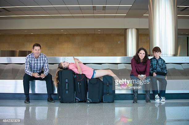 family at airport between flights