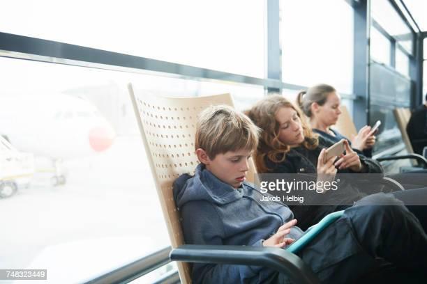 Family at airport on way to holiday, Copenhagen, Denmark
