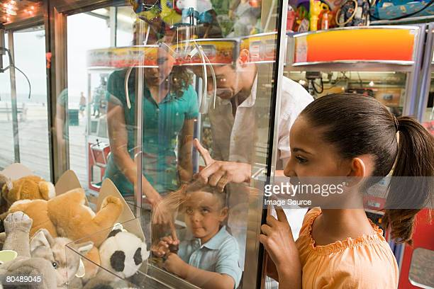 family at amusement arcade - arcade stock photos and pictures